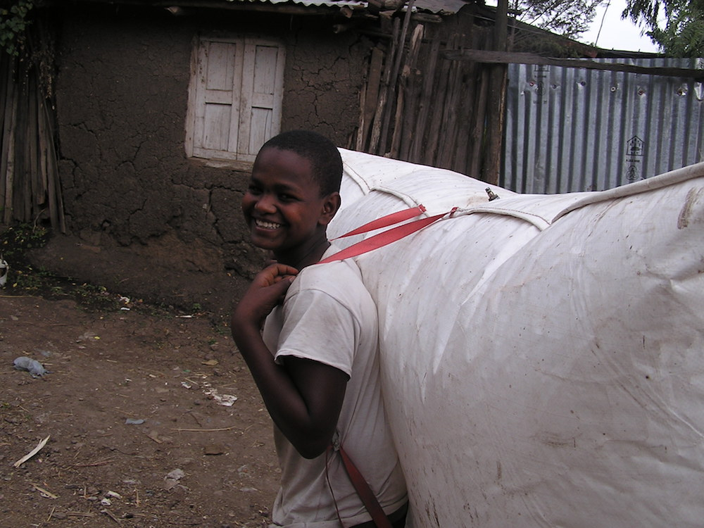 (B)pack: biogas backpack being carried by boy